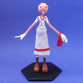 Boneca Olivia Palito com saia de tecido