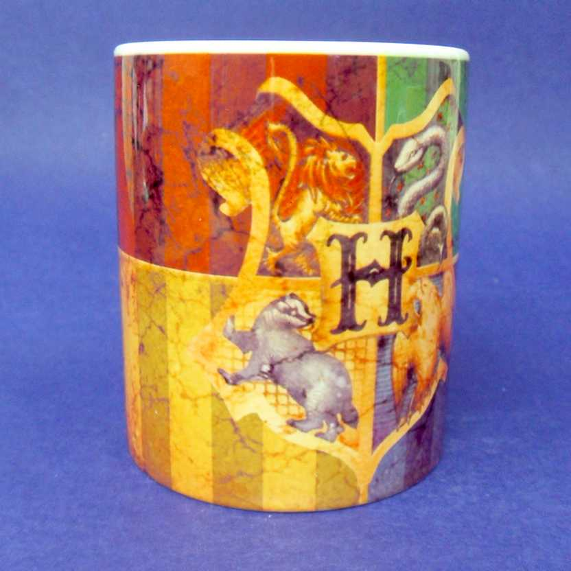Caneca do Harry Potter - Hogwarts Houses ( pode ir ao microondas )
