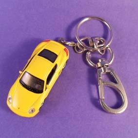 Chaveiro Porsche Cayman S marca Welly Chaveiros escala 1/87 HO